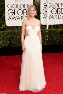 Rosamund Pike turns heads in a white full length cut-out dress