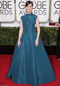 Felicity Jones in a high-neck sleaveless teal dress