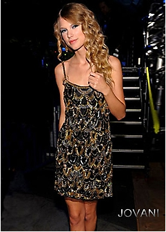 Taylor Swift glitters in Jovani. Available at Girl Meets Dress