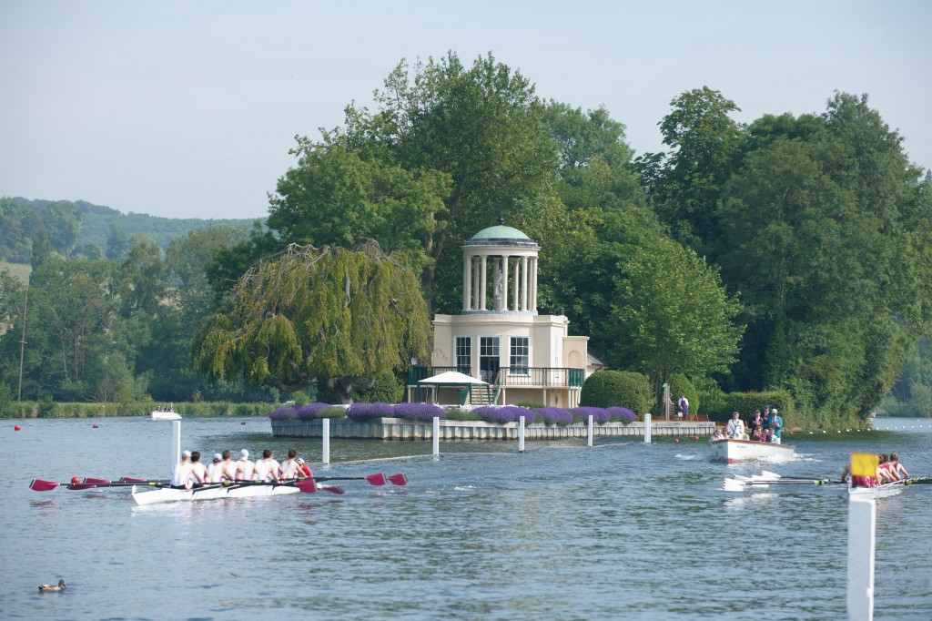BJ4C09 Two boats rowing passed Temple Island at Henley Regatta